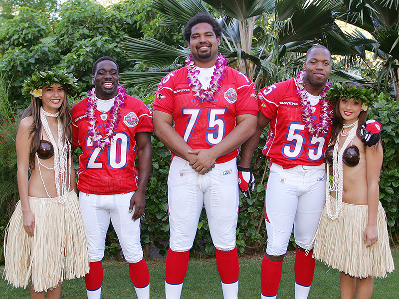 KO OLINA - FEBRUARY 10:  Baltimore Ravens 2005 NFL Pro Bowl AFC All-Stars (left to right: Ed Reed #20, Jonathan Ogden #75, and Terrell Suggs #55) pose with Hawaiian Hula girls for their 2005 NFL Pro Bowl team photo on February 10, 2005 in Ko Olina, Hawaii. (Photo by Paul Spinelli/Getty Images)